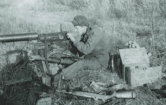 Robert Faris with a Chinese Type 24 Maxim in Korea