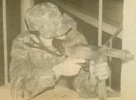 Author firing an Uru SMG from cover