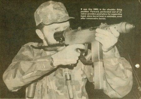 Author firing an Uru SMG