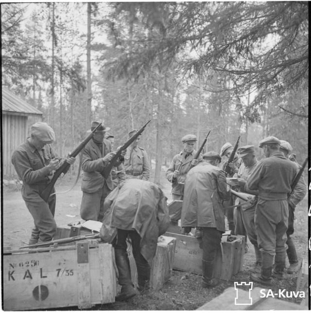 Finnish militiamen being issued 7.35mm Carcano rifles