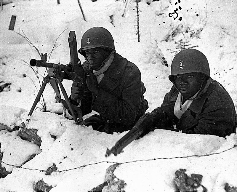 Senegalese Free French soldiers at the Battle of the Bulge in 1944, armed with a British Bren and an American 1903 Springfield.