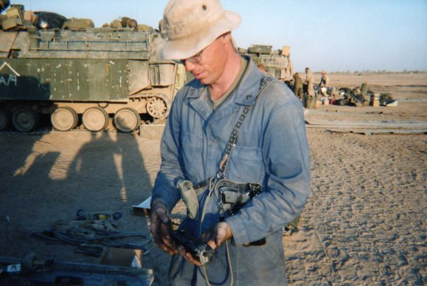 Nick Crawford inspecting arms in Iraq