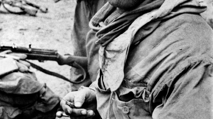 German soldier cleaning his rifle