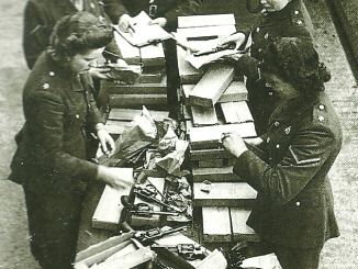 British women sort through guns donated by Americans for the Home Guard.