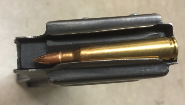 XM-19 magazine with a 5.56mm NATO cartridge for scale reference