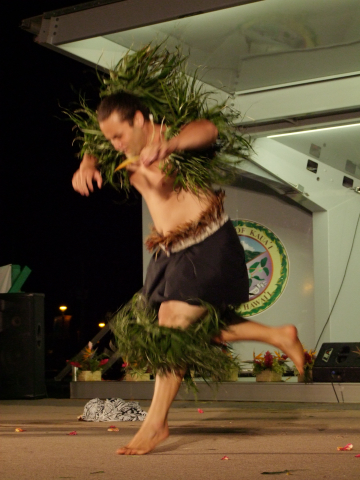 Tahitian style dancer Leaps onto stage