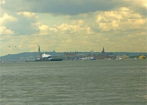 Statue of Liberty and Ellis Island behind the Shuttle Enterprise