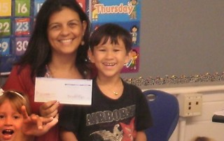 Koloa Kindergarten teacher Mrs. Naihe and top recycler Keenan Luis