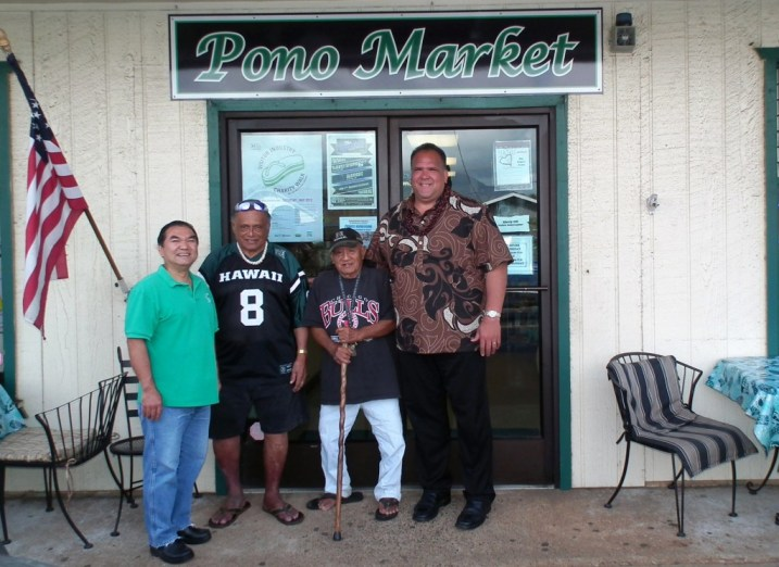 Mayor Bernard Carvalho, Jr. (far right) recently stopped in at Pono Market to thank Robert Kubota, owner of Pono Market (far left), for being the first business for agreeing to sell Kaua'i Bus passes beginning May 21. Also shown are two regular Pono Market customers John Kauo (third from left) and Marcelo Baldonado (second from right).