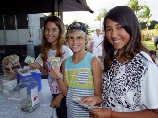 L-R: Elliana Ramire and two Chiefess Kamakahelei students, Carter Sieverts and Kayla Dotario line up for dishes from Cabello's.