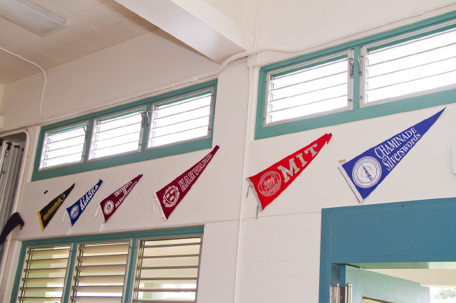 College pennants in the cafeteria, gifts of Koloa School graduates who graduated from the college