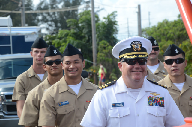 Commander Garron Morris, Pacific Missile Range Facility executive officer, leads a group of sailors marching in the annual Kaua`i Veterans Day Parade. More than 20 sailors participated.
