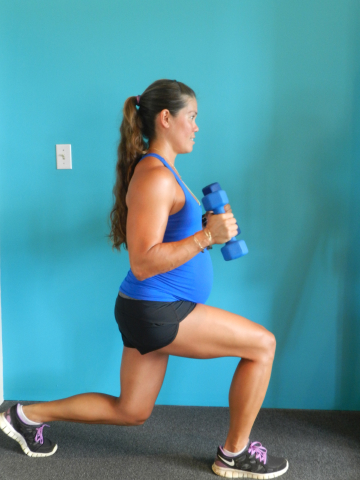 Kristin Foster in her eighth month of pregnancy doing the lunge