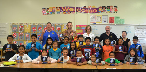 (Back row from left) Rotarians Jay Gautney, Kevin Allison, Valerie Parker, Stefan Alford and Leanna Gautney pose with a third grade class at Eleele Elementary School who proudly their new dictionaries donated by the Rotary Club of West Kauai on Feb. 27. More than 100 third-grade students at four schools received student dictionaries as part of the club's annual community program. (Courtesy Photo)