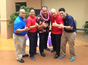 From left to right, Alvin Taio, general manager of Sports Authority on the Big Island, Patrick Chung, general manager of Sports Authority in Waikele, O'ahu, Mayor Bernard Carvalho Jr., James Saladin, general manager of Sports Authority on Kaua'i, and Chris Martinez, general manager of Sports Authority in Honolulu.