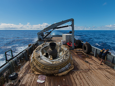 """The first """"flown"""" test vehicle of Low-Density Supersonic Decelerator project relaxes aboard the recovery vessel Kahana. During the June 28, 2014, engineering flight, the saucer-shaped test vehicle climbed to over 180,000 feet (about 55,000 meters) in altitude and went as fast as four times the speed of sound."""