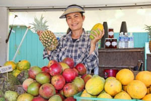 The Kaua'i Fruit Stand by Kapa'a Beach Park has been around for four years, offering mostly local fruits daily from 8 a.m. to 6 p.m. Employee Lek Aksorn is all smiles, surrounded by mangos, apple bananas, sour sap, lemons, mountain apples, avocados, pineapples, papayas, lilikoi and coconuts.