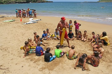 Lifeguard Eugene Ancheta is seen here instructing junior lifeguard students at Kalapaki Beach.