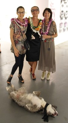 Margaret Ezekiel, left, Galerie 103 owner Bruna Stude, center and Sally French, with Brolie acting up.