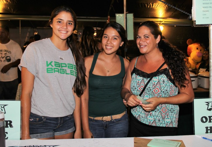 Erika Keoho, left, Shaniya Martins, center, and Lana Simmons, fundraising for Kapa'a Pop Warner.