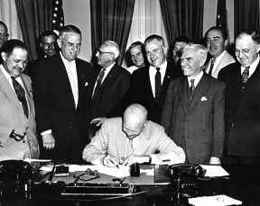 President Dwight Eisenhower signing HR7786, changing Armistice Day to Veterans Day. From left: Alvin J. King, Wayne Richards, Arthur J. Connell, John T. Nation, Edward Rees, Richard L. Trombla, Howard W. Watts.