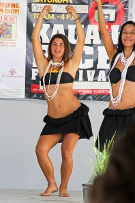 Tahitian dancers Sol Jorducha, left, and Ilima Ursomarso.