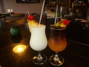 Our server and bartender, Debbie, made us a Mai Tai and a Pina Colada, show here. But then she asked if I wanted to try a Caipirinha, with bitter Brazilian rum, muddled limes, and simple syrup. It's like Margarita's less sweet sister who means business. When in Rome…