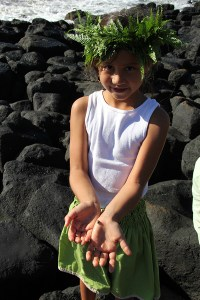 'Anonui Emery shows a tiny crab she found at Maha'ulepu Beach.
