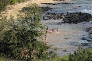 Visitors playing at the mouth of Waiopili Stream, the most polluted stream on Kaua'i.