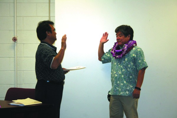 Kirk Saiki was sworn in yesterday as the Department of Water's newly appointed manager and chief engineer by Eddie Topenio, Jr., administrative assistant to the County Clerk.