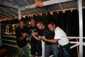 Mike Young, second from left, and I, wearing a white shirt, at Tom Kats in 2009.
