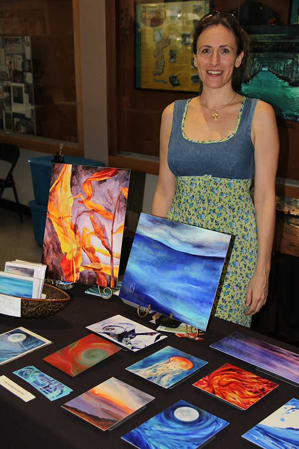 Donia Lilly with her artwork.