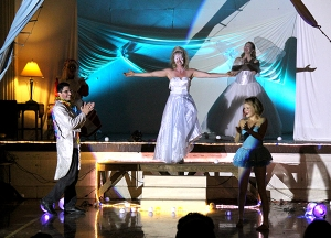 Snow Queen Joanna Maltas walks down the steps, with Yacine Merzouk and Corissa Berrett flanking her, and Fairy Tawna Bensaid in the back.