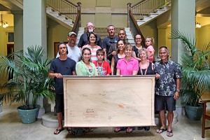 Malina Pereza's family holds a 1913 Kekaha Sugar Co. map in the Historic County Building in Lihu'e in March. Pereza spearheaded the preservation and cataloguing of hundreds of maps before losing a battle to leukemia last June, at 26 years old.