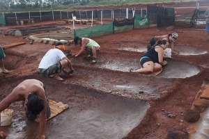 The Santos family at work in the Hanapepe salt beds. Photo by Piilani Kali