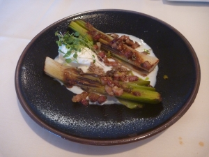 Bichotan Grilled Leek, served with wet bacon, sunflower pesto, toasted buttermilk and whipped goat cheese.