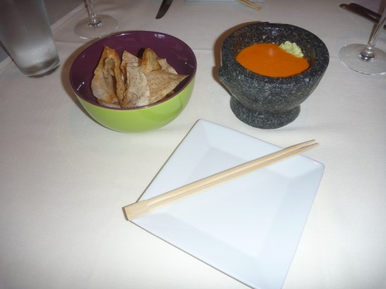 Every meal starts off with house made Hanalei taro chips and cool poached tomato wasabi dipping sauce.