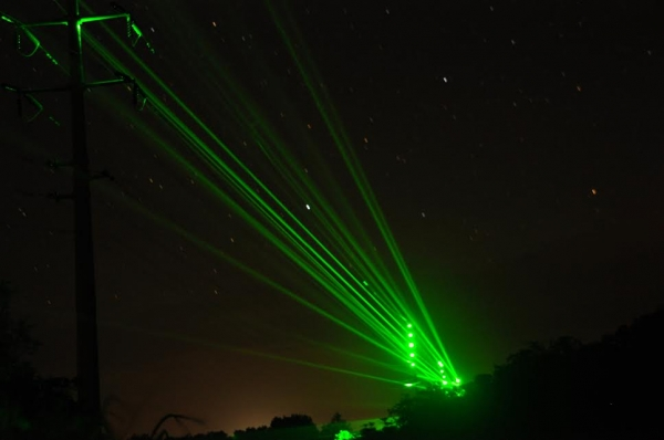 "Lasers create a ""light fence"" to illuminate transmission poles and power lines in 'Ele'ele, Kaua'i in August 2014. Photo credit: Shelley Paik, Kaua'i Island Utility Cooperative"