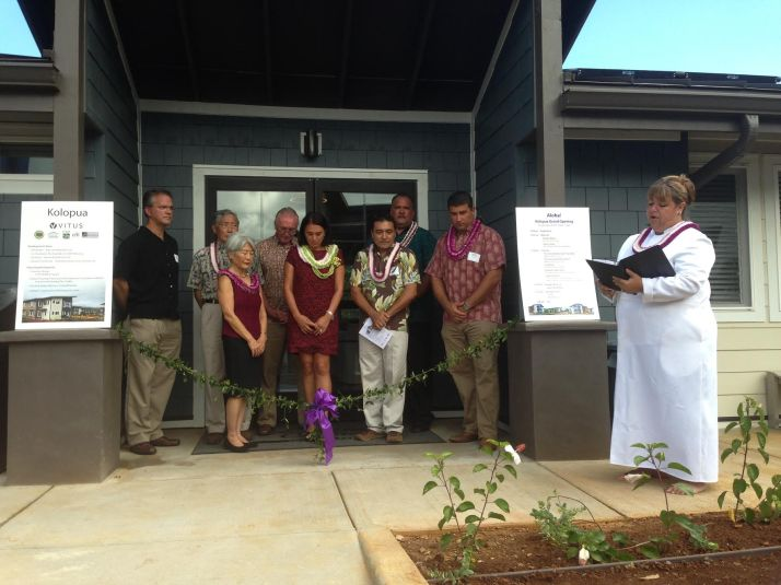 Kahu Jade Battad blesses the newly opened workforce housing complex in Princeville called Kolopua. From L to R: Brian McDonell, City Real Estate Advisors; Craig Hirai, Hawai'i Housing Finance and Development Corp.; JoAnn Yukimura, Kaua'i County Council Member; Kevin Carney, EAH Housing; Makani Maeva, Vitus Group; Hawai'i State Rep. Mark Hashem; Mayor Bernard Carvalho, Jr. and Kamuela Cobb-Adams, Kaua'i County Housing Agency.