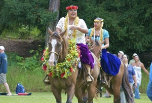 Queen Emma, played by Helen Leilani Santiago, rides into the Meadow in Koke'e with her lady-in-waiting during last year's Eo e Emalani i Alaka'i. Photo by Danny Hashimoto