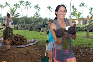 Is Stacey Ricciardi modeling her work gloves or just enthusiastically sharing double shakas as she and fellow volunteers clear lauhala from the Hikina'akala Heiau? Create some new friendships on National Make A Difference Day in Lydgate Park Oct. 24. Contributed photo.