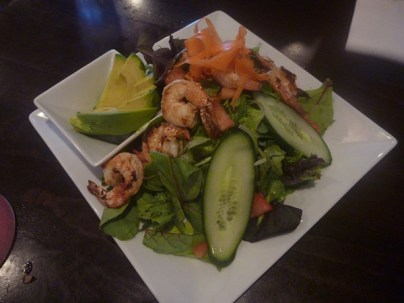 Shrimp and Avocado salad with local greens and savory shrimp. All dressings are homemade.