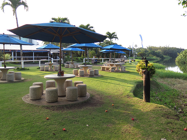 Outside seating by Hanalei River.