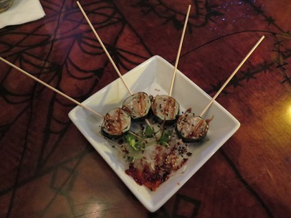 These are our surprise Scallop Lollipops, served with a tumble of seasoned sprouts and ginger. They are simple and fun, a great palette cooler and the drizzled sauce actually made them sweet.