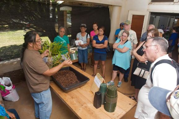 Dennis Olivoa gives orchid potting demonstration.