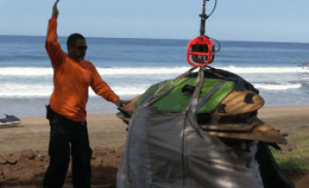 Surfboards, body boards and other property found in illegal campsites are seen here being airlifted out of Kalalau by DLNR. Video grab DLNR