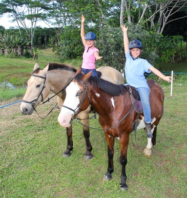 Ruby Arnold, left, mounting Duchess, and Melela'i Sproat-Beck, mounting Matisse, are seen here performing hula during the Equine Enrichment and Empowerment Education program.