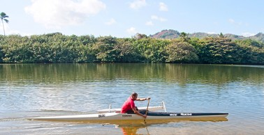 Luke Evslin is seen here paddling his one-man outrigger canoe at Wailua River.