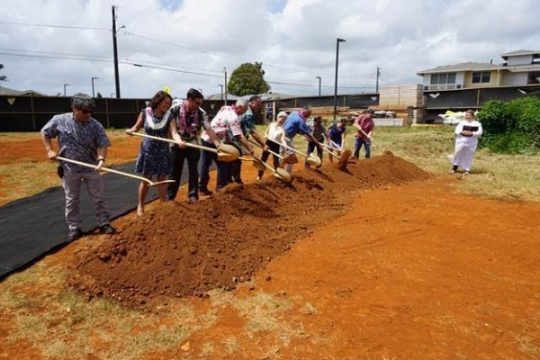 Officials take part in the ceremonial shoveling of the dirt at Friday's Kaniko'o Phase II groundbreaking. From L-R: Department of Water Manager Kirk Saiki; Vitus Development Owner Makani Maeva; Milo Spindt, Kauai Board Member of HHFDC; Bill Bow, Bow Engineering and Development; Mayor Bernard Carvalho; Council Member JoAnn Yukimura; Housing Development Coordinator Gary Mackler; Project Manager for Kaniko'o Helito Caraang of Shioi Construction; Housing Director Kanani Fu; Scott Settle of Settle Meyer Law; and Kahu Jade Wai'ale'ale Battad.