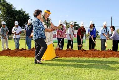 Sabra Kauka, accompanied by Sonia Topenio, blesses the land during the Kaua'i  Philippine Cultural Center groundbreaking ceremony March 29.